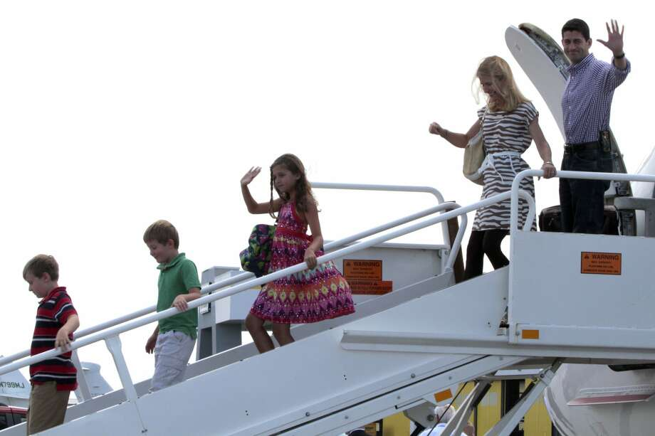 Republican vice presidential candidate, Rep. Paul Ryan, R-Wis.,  follows his family upon their arrival at Tampa International Airport in Tampa, Fla.,Tuesday, Aug. 28  ,2012. From left are, sons Charlie and Sam, daughter Liza and wife Janna.  (AP Photo/Mary Altaffer) (Mary Altaffer / Associated Press)