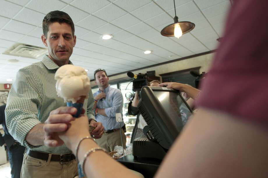 Republican vice presidential candidate, Rep. Paul Ryan, R-Wis., buys ice cream at Puritan Backroom restaurant, Saturday, Aug. 25, 2012 in Manchester, N.H.  (AP Photo/Mary Altaffer) (Mary Altaffer / Associated Press)