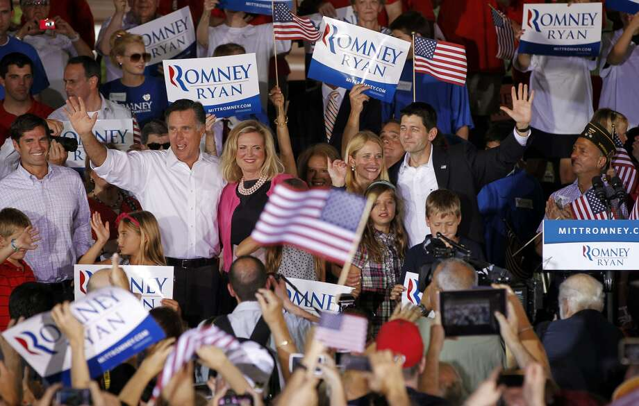 "FILE - In this Aug. 11, 2012, file photo Republican presidential candidate, former Massachusetts Gov. Mitt Romney, with his wife Ann, and his newly announced vice presidential running mate, Rep. Paul Ryan, R-Wis., far right, and his wife, Janna, during a campaign rally in Manassas, Va. The Romneys envision a White House enlivened by ""little feet in the hallway"", 18 visiting grandkids and they are dishing out personal details as they try to warm up a candidate burdened by a cold-fish image. America may not be ready for this one: Instead of syrup, Mitt Romney slathers his pancakes with peanut butter. (AP Photo/Pablo Martinez Monsivais, File) (Pablo Martinez Monsivais / Associated Press)"