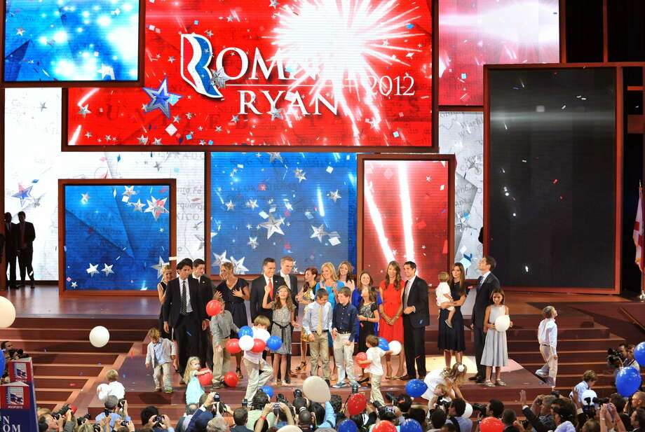 Republican presidential candidate Mitt Romney and Vice presidential nominee  Paul Ryan and their family members stand on stage at the Tampa Bay Times Forum in Tampa, Florida, on August 30, 2012 on the final day of the Republican National Convention (RNC). The RNC culminates today with the formal nomination of Mitt Romney and Paul Ryan as the GOP presidential and vice-presidential candidates in the US presidential election.   AFP PHOTO Stan HONDASTAN HONDA/AFP/GettyImages (AFP/Getty Images)