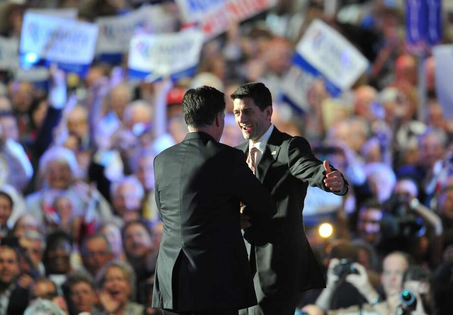 TOPSHOTS Republican presidential candidate Mitt Romney (R) and vice presidential nominee Paul Ryan hugeach other on the stage at the Tampa Bay Times Forum in Tampa, Florida, on August 30, 2012 on the final day of the Republican National Convention (RNC). The RNC culminates today with the formal nomination of Mitt Romney and Paul Ryan as the GOP presidential and vice-presidential candidates in the US presidential election.  AFP PHOTO / Mladen ANTONOVMLADEN ANTONOV/AFP/GettyImages (AFP/Getty Images)