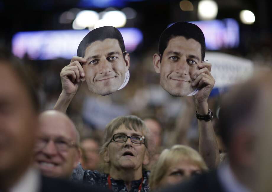 A delegate holds up a mask of Republican vice presidential nominee, Rep. Paul Ryan during the Republican National Convention in Tampa, Fla., on Wednesday, Aug. 29, 2012. (AP Photo/David Goldman) (Associated Press)