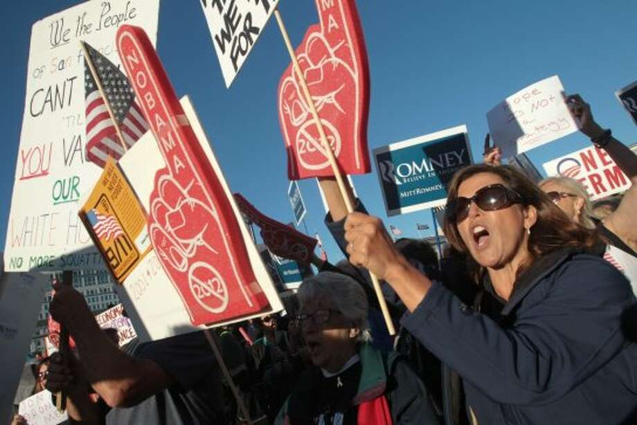 Liz Biagini and other Mitt Romney supporters chant anti-Obama slogans outside a campaign event for President Barack Obama in San Francisco on Monday, Oct. 8, 2012. (AP Photo/Mathew Sumner) (Associated Press)