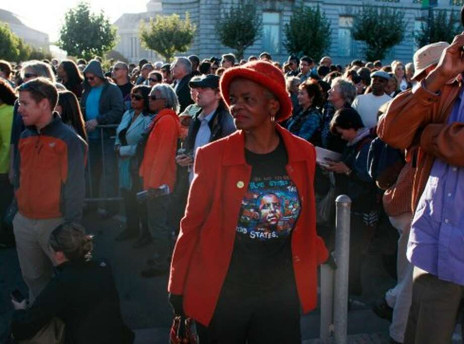 Hilda Robinson, of Oakland, waits for Obama to arrive for a fundraiser at the Bill Graham Civic Auditorium on Monday Oct. 10, 2012 in San Francisco, Calif. (The Chronicle)
