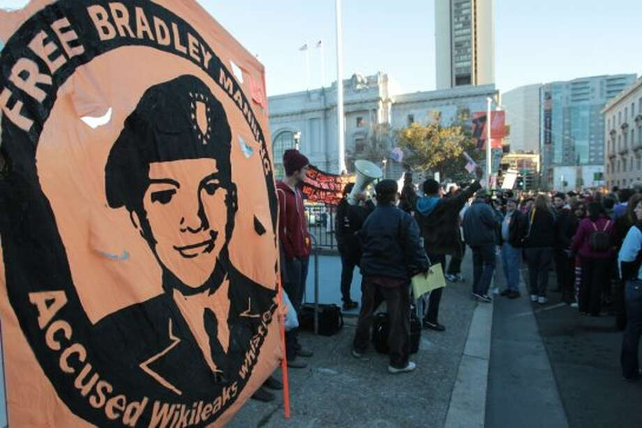 A sign supporting Bradley Manning hangs outside a campaign event for President Barack Obama in San Francisco on Monday, Oct. 8, 2012. (AP Photo/Mathew Sumner) (Associated Press)