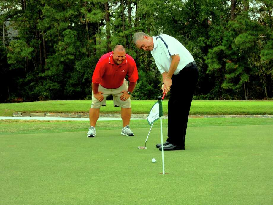 Jim Dickson, The Woodlands Country Club director of golf, putts on the practice green that has a MiniVerde grass surface, like the other 18 greens on the course. With Dickson is Chris Hartman, the Tournament Course superintendent. Photo: Handout