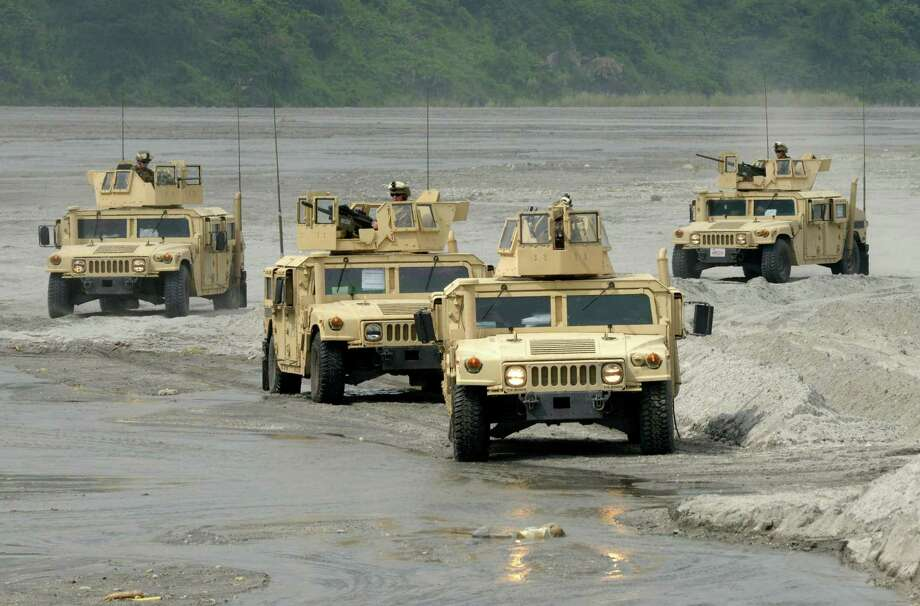 US Marines maneuver their jeeps at Crow Valley, Tarlac province in northern Philippines on October 9, 2012, as part of the annual 10 day Philippine-US Amphibious Landing Exercises program. Photo: JAY DIRECTO, AFP/Getty Images / AFP