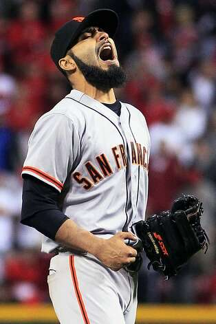 San Francisco Giants relief pitcher Sergio Romo reacts after the Giants defeated the Cincinnati Reds 2-1 in 10 innings in Game 3 of the National League division baseball series, Tuesday, Oct. 9, 2012, in Cincinnati. Photo: Al Behrman, Associated Press