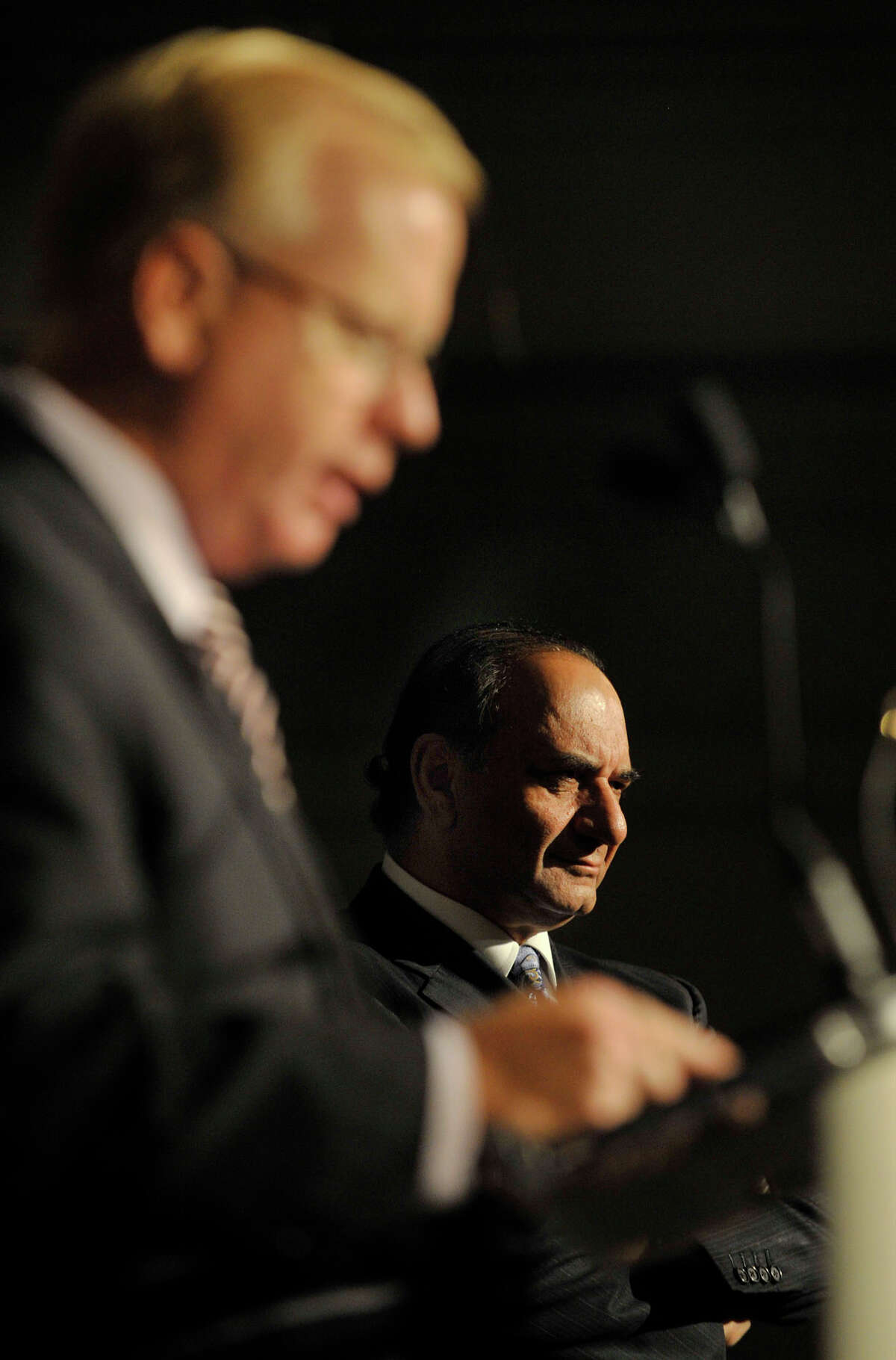 Danbury Mayor Mark Boughton, left, speaks and Farooq Kathwari, president and CEO of Ethan Allen, listens on stage during a reception celebrating the company's 80th anniversary at the Ethan Allen Hotel in Danbury on Tuesday, Oct. 9, 2012.
