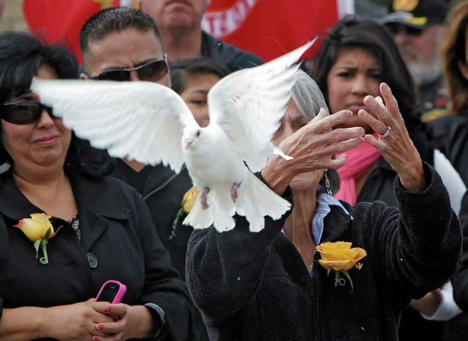 Delouise Guerra, the sister of Marine PFC James Jacques, releases one of 21 doves after his funeral at Fort Logan National Cemetery in Denver on Tuesday, Oct. 9, 2012. The Jacques funeral was held 37 years after he was killed during the rescue of the crew of an American cargo ship seized by Cambodia in May of 1975. His remains were identified in August 2012. Photo: Ed Andrieski, Associated Press / AP