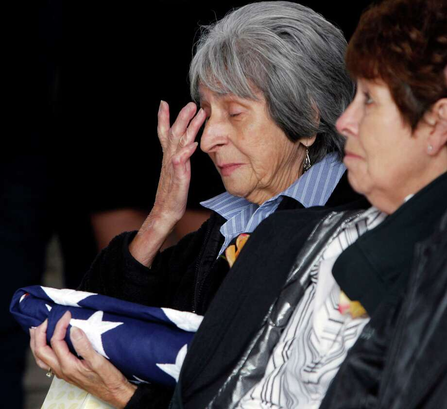 Delouise Guerra the sister of Marine  PFC James Jacques wipes away tears at his funeral at Fort Logan National Cemetery in Denver on Tuesday, Oct. 9, 2012.  The Jacques funeral was held 37 years after he was killed during the rescue of the crew of an American cargo ship seized by Cambodia in May of 1975.  His remains were identified in August 2012. Photo: Ed Andrieski, Associated Press / AP