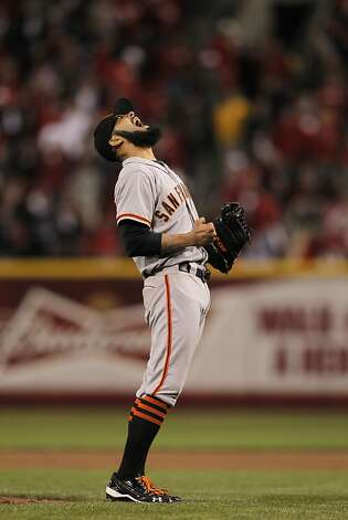 Giants' closing pitcher Sergio Romo lets out a scream as he make the final out in the bottom of the tenth inning to give the San Francisco Giants the win over the Cincinnati Reds 2-1 in game three of the National League Division Series in Cincinnati, Ohio on Tuesday Oct. 9, 2012. Photo: Michael Macor, The Chronicle