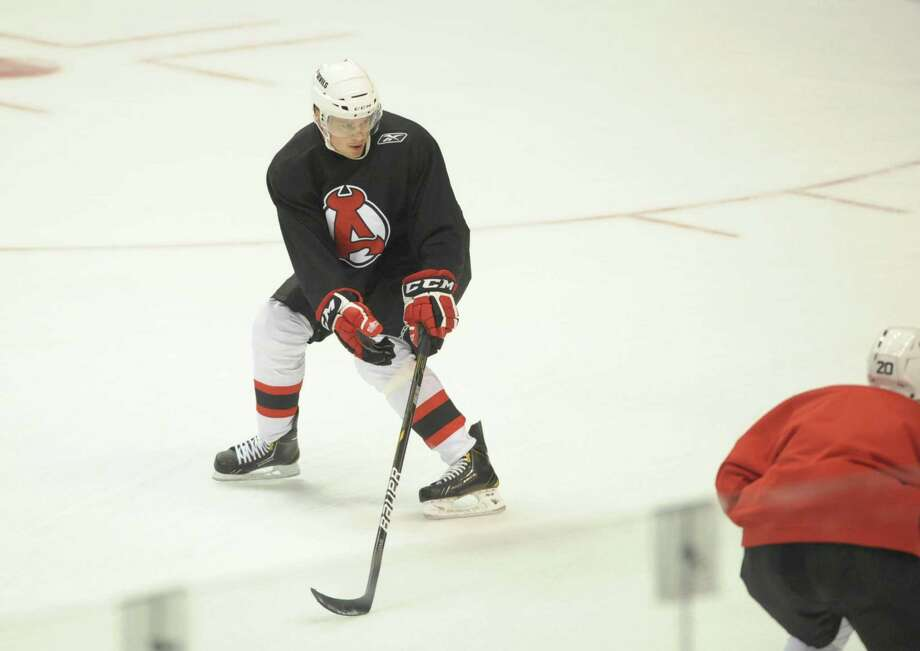 Defenseman Adam Larsson, left, runs through drills during the Albany Devils hockey practice at the Times Union Center on Tuesday, Oct. 9, 2012 in Albany, NY.   (Paul Buckowski / Times Union) Photo: Paul Buckowski