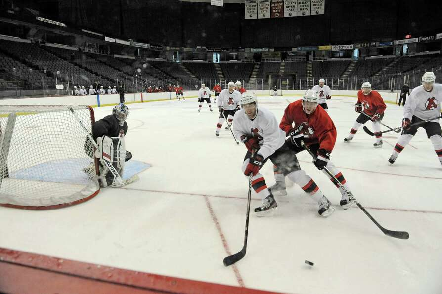 Players scrimmage each other during the Albany Devils hockey practice at the Times Union Center on T