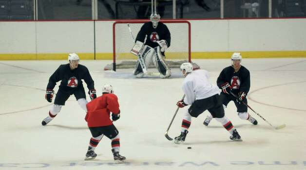 Players run through a drill during the Albany Devils hockey practice at the Times Union Center on Tuesday, Oct. 9, 2012 in Albany, NY.   (Paul Buckowski / Times Union) Photo: Paul Buckowski