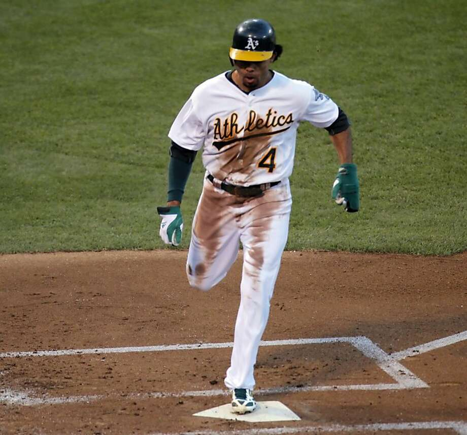Coco Crisp scores the winning run - in the first inning. It's all the A's would need, partly thanks to his leaping catch in center field a half-inning later. Photo: Carlos Avila Gonzalez, The Chronicle