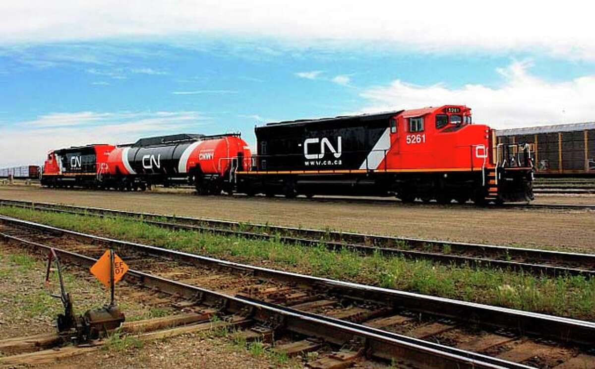 The Canadian National Railway is experimenting with natural gas as a train fuel, which involves adding a liquefied natural gas tank behind the locomotive. (Canadian National Railway photo)