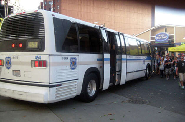 "The police buses are there to guard against terrorist attacks. ""The NFL enacted special rules because of 911,"" Sgt. Paul Gracy said in 2010. ""Those buses are being used to block the roadway in case somebody wants to drive in with a bomb."" CenturyLink Field can fit between 67,000 and 72,000 people depending on the event. The stadium has roughly 10,000 cubic yards of concrete -  equal to a 3-foot sidewalk from Seattle to Boise, Idaho. The roof has 5,700 tons of steel, according to Seahawks officials. Outside of NFL games, the buses are used for transportation of officers, or transportation of large prisoner groups. Photo: Seattlepi.com File"