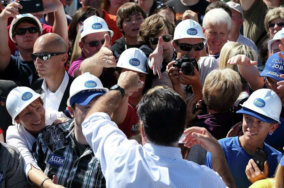The Republican presidential candidate, former Massachusetts Gov. Mitt Romney, greets supporters this month in coal territory in Abingdon, Va. Photo: Justin Sullivan / 2012 Getty Images