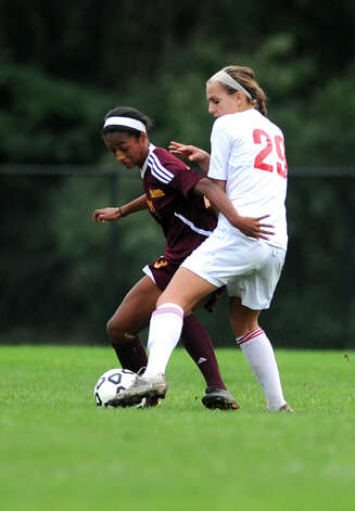 St. Joseph's Leah Lewis, left, and Fairfield Warde's Emma Patrone battle for the ball during their soccer match Tuesday, Oct. 9, 2012 at Fairfield Warde High School. Photo: Autumn Driscoll / Connecticut Post