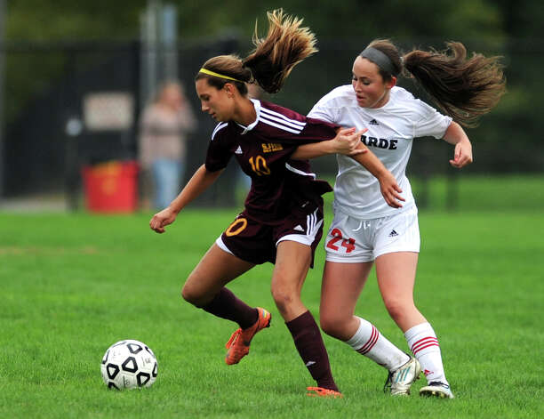 St. Joseph's Jenna Bike controls the ball as Fairfield Warde's Kaitlyn O'Brien defends during their soccer match Tuesday, Oct. 9, 2012 at Fairfield Warde High School. Photo: Autumn Driscoll / Connecticut Post