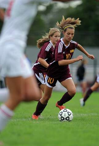 St. Joseph's Jenna Bike controls the ball during their soccer match against Fairfield Warde Tuesday, Oct. 9, 2012 at Fairfield Warde High School. Photo: Autumn Driscoll / Connecticut Post