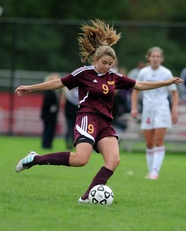 St. Joseph's Sabrina Toole passes the ball during their soccer match against Fairfield Warde Tuesday, Oct. 9, 2012 at Fairfield Warde High School. Photo: Autumn Driscoll / Connecticut Post