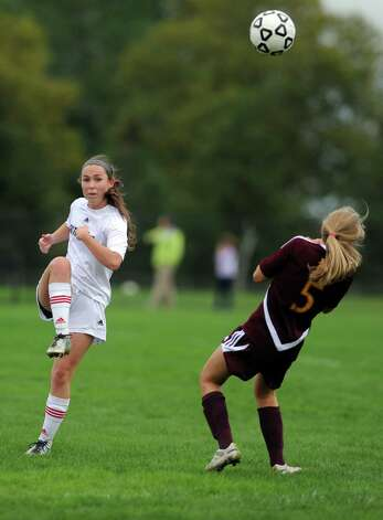 Fairfield Warde's Kaitlyn O'Brien passes the ball as St. Joseph's Julia Marino defends during their soccer match Tuesday, Oct. 9, 2012 at Fairfield Warde High School. Photo: Autumn Driscoll / Connecticut Post