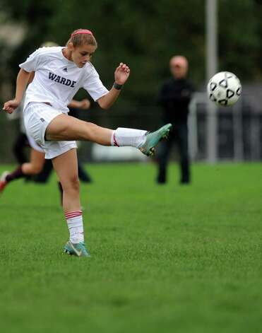 Fairfield Warde's Jenn Maldenado kicks the ball during their soccer match against St. Joseph Tuesday, Oct. 9, 2012 at Fairfield Warde High School. Photo: Autumn Driscoll / Connecticut Post
