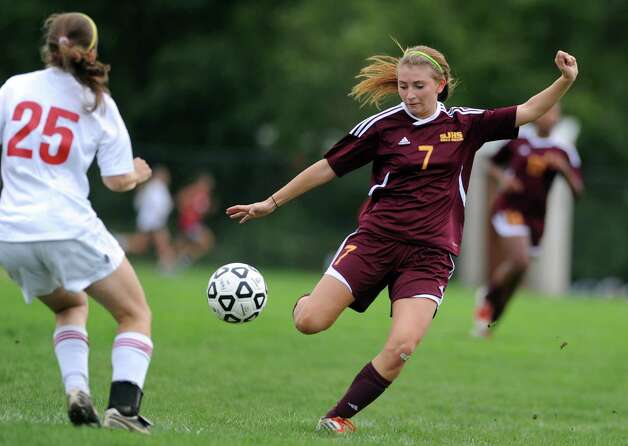 St. Joseph's Katie Danaher controls the ball as Fairfield Warde's Megan Overby defends during their soccer match Tuesday, Oct. 9, 2012 at Fairfield Warde High School. Photo: Autumn Driscoll / Connecticut Post