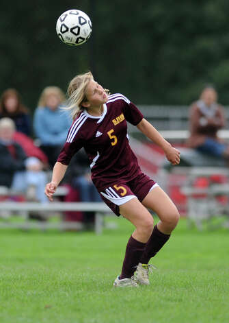 St. Joseph's Julia Marino heads the ball during their soccer match against Fairfield Warde Tuesday, Oct. 9, 2012 at Fairfield Warde High School. Photo: Autumn Driscoll / Connecticut Post