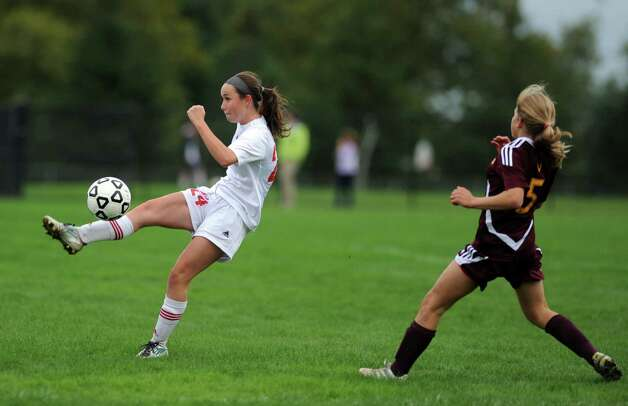 Fairfield Warde's Kaitlyn O'Brien controls the ball as St. Joseph's Julia Marino defends during their soccer match Tuesday, Oct. 9, 2012 at Fairfield Warde High School. Photo: Autumn Driscoll / Connecticut Post