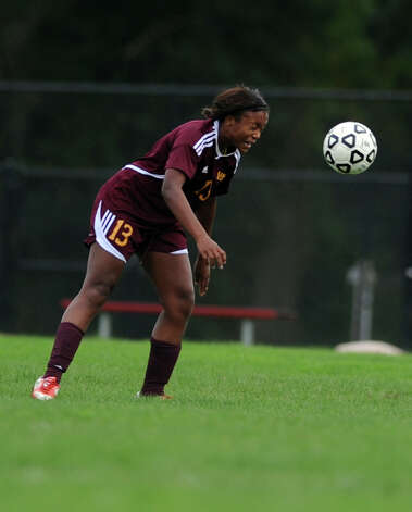 St. Joseph's Cori Scales heads the ball during their soccer match against  Fairfield Warde Tuesday, Oct. 9, 2012 at Fairfield Warde High School. Photo: Autumn Driscoll / Connecticut Post