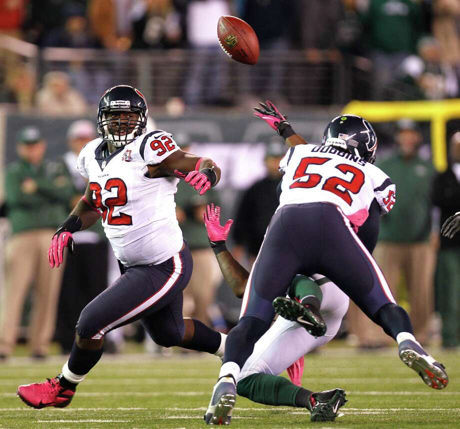 Tim Dobbins (52) will be one of the players who will get a shot at replacing Brian Cushing. Photo: Brett Coomer / © 2012  Houston Chronicle