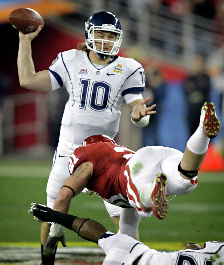 Connecticut quarterback Zach Frazer (10) throws as Oklahoma linebacker Tom Wort (21) dives in during the first quarter of the Fiesta Bowl NCAA college football game Saturday, Jan. 1, 2011, in Glendale, Ariz. Photo: Matt York, AP / AP