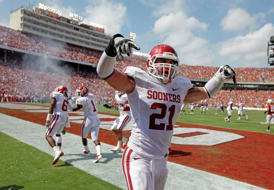 Oklahoma's Tom Wort (21) celebrates after a touchdown by Oklahoma's Demontre Hurst (6) during the Red River Rivalry college football game between the University of Oklahoma Sooners (OU) and the University of Texas Longhorns (UT) at the Cotton Bowl in Dallas, Saturday, Oct. 8, 2011. Photo: Bryan Terry, The Oklahoman / THE OKLAHOMAN