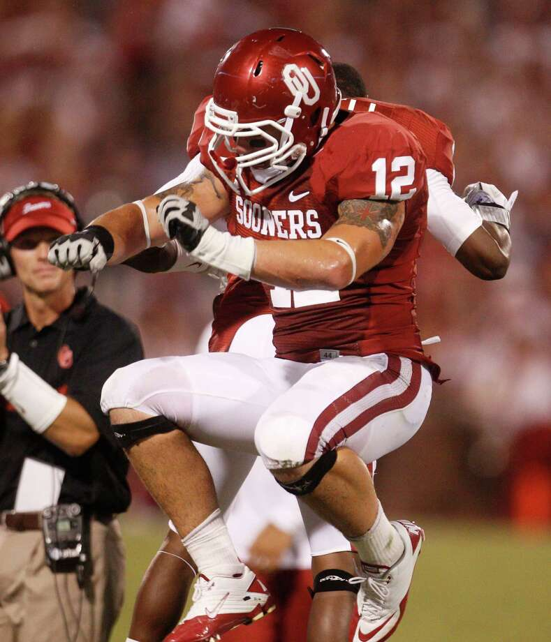 Oklahoma linebacker Tom Wort celebrates with a teammate after Oklahoma recovered a fumble by Tulsa in the second quarter of an NCAA college football game in Norman, Okla., Saturday, Sept. 3, 2011. Photo: Sue Ogrocki, Associated Press / AP
