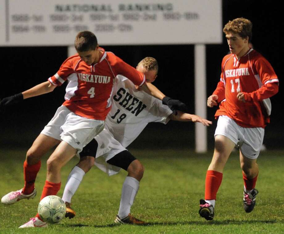 Niskayuna's Chris Downing, left, and Shen's Tucker Marvin battle for the ball during the Shenendehowa vs Niskayuna boys high school soccer game in  Clifton Park, NY Tuesday Oct. 9, 2012. (Michael P. Farrell/Times Union) Photo: Michael P. Farrell
