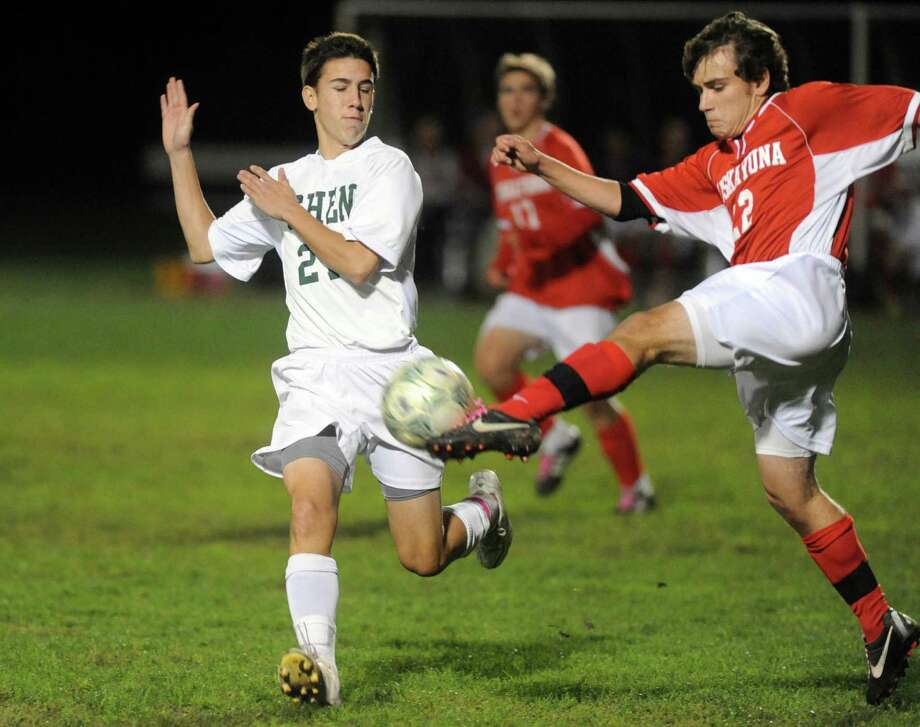 Shen's Austin Hughes, left, and Niskayuna's Michael Law battle for the ball during the Shenendehowa vs Niskayuna boys high school soccer game in  Clifton Park, NY Tuesday Oct. 9, 2012. (Michael P. Farrell/Times Union) Photo: Michael P. Farrell