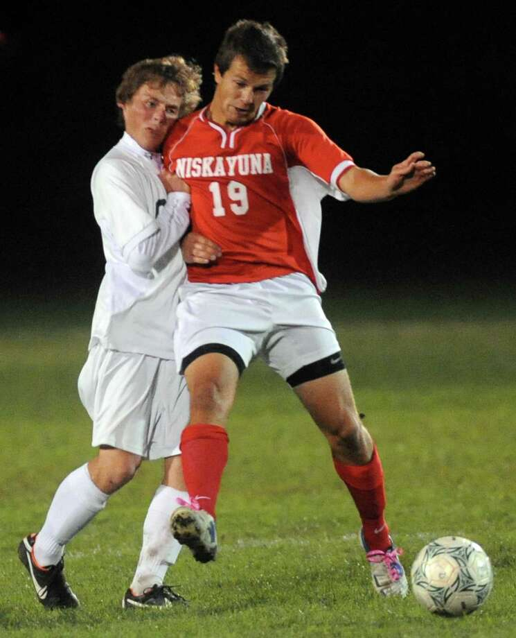 Shen's Adam Bindelglass, left, and Niskayuna's Phillip Weeber collide as they battle for the ball during the Shenendehowa vs Niskayuna boys high school soccer game in  Clifton Park, NY Tuesday Oct. 9, 2012. (Michael P. Farrell/Times Union) Photo: Michael P. Farrell