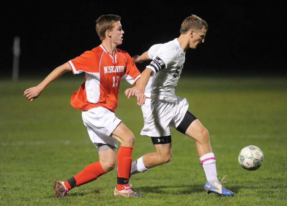 Niskayuna's Colby Vickerson, left, and Shen's Philip Barrett battle for the ball during the Shenendehowa vs Niskayuna boys high school soccer game in  Clifton Park, NY Tuesday Oct. 9, 2012. (Michael P. Farrell/Times Union) Photo: Michael P. Farrell