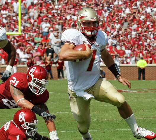 Florida State quarterback Christian Ponder (right) gains yardage as he moves around Oklahoma linebacker Tom Wort (top left) and defensive back Tony Jefferson (bottom left) in the first quarter of an NCAA college football game in Norman, Okla., Saturday, Sept. 11, 2010. Photo: Sue Ogrocki, Associated Press / AP