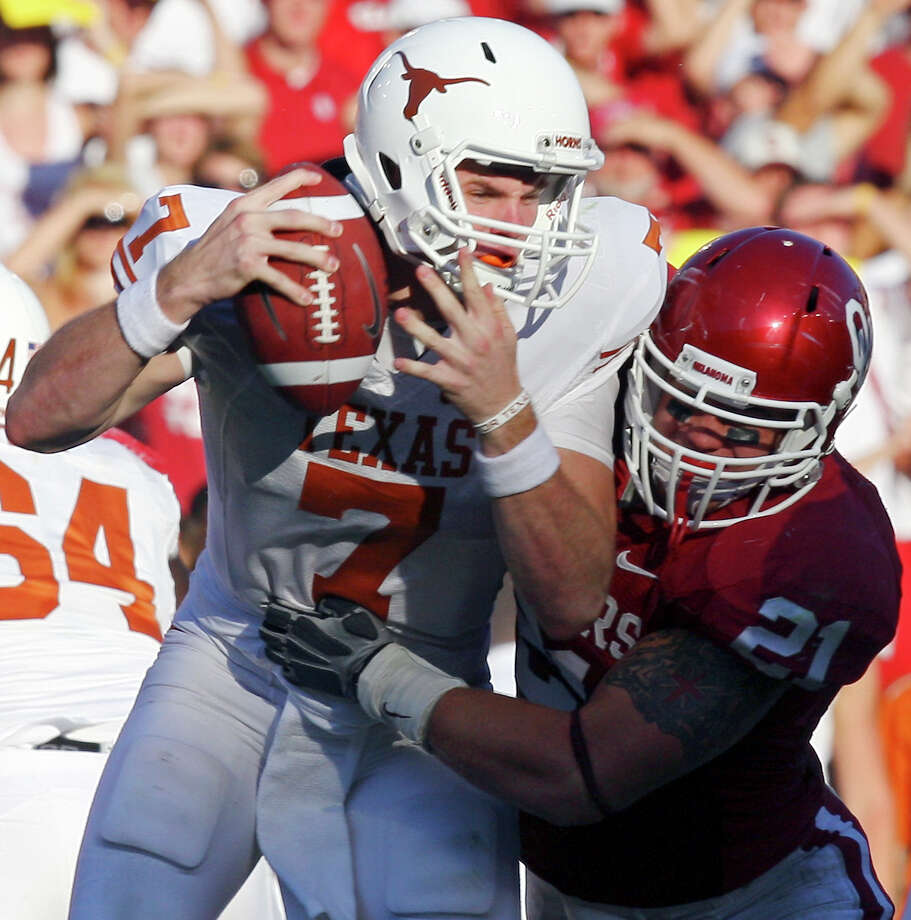 Texas Longhorns' Garrett Gilbert is sacked by Oklahoma Sooners' Tom Wort during second half action Saturday, Oct. 2, 2010, of the Red River Rivalry at the Cotton Bowl in Dallas, Tx. The Oklahoma Sooners won 28-20. Photo: Edward A. Ornelas, San Antonio Express-News / eaornelas@express-news.net
