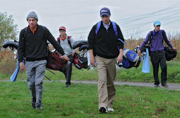From left, leaders Victor Fox of Bethlehem H.S., Alex Gibson of Glens Falls H.S., Davis Jensen of Shaker H.S. and Matt Parrottino of Voorheesville H.S. make their way to the 11th hole during the Section II A-B-C-D golf championships at Orchard Creek Golf Course Tuesday, Oct. 9, 2012 in Altamont, N.Y. (Lori Van Buren / Times Union) Photo: Lori Van Buren