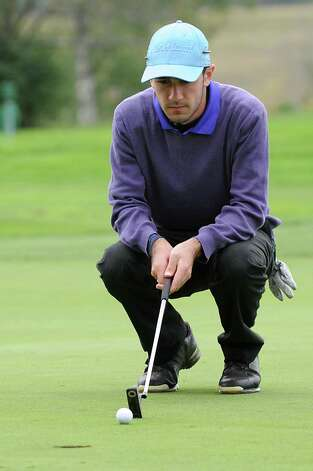 Matt Parrottino of Voorheesville H.S. lines up his next putt during the Section II A-B-C-D golf championships at Orchard Creek Golf Course Tuesday, Oct. 9, 2012 in Altamont, N.Y. (Lori Van Buren / Times Union) Photo: Lori Van Buren