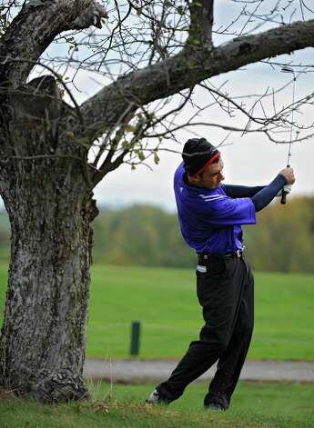 Matt Parrottino of Voorheesville H.S. hits a great fairway shot from behind an apple tree during the Section II A-B-C-D golf championships at Orchard Creek Golf Course Tuesday, Oct. 9, 2012 in Altamont, N.Y. (Lori Van Buren / Times Union) Photo: Lori Van Buren