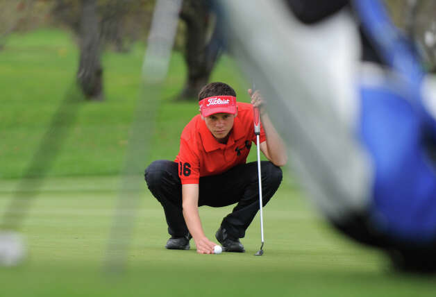 Alex Gibson of Glens Falls H.S. gets ready to putt during the Section II A-B-C-D golf championships at Orchard Creek Golf Course Tuesday, Oct. 9, 2012 in Altamont, N.Y. (Lori Van Buren / Times Union) Photo: Lori Van Buren