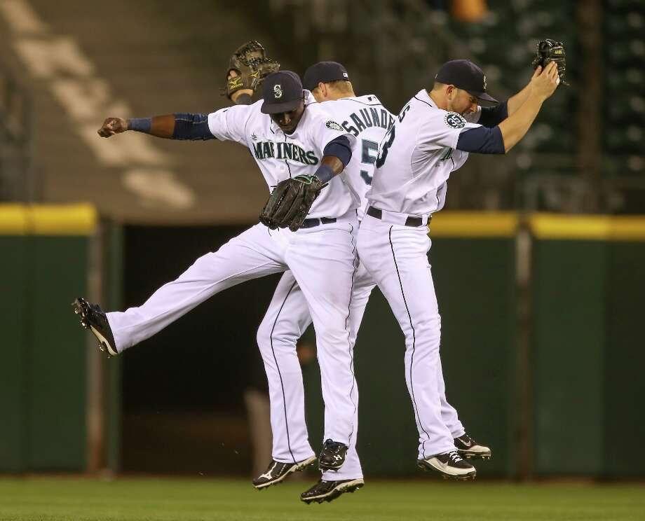 That's better: Though the rankings at season's end didn't exactly show it, the 2012 Mariners were much better offensively than the 2011 club. They hit 40 more home runs and scored 63 more runs than a year ago. Photo: Otto Greule Jr, Getty Images / 2012 Getty Images