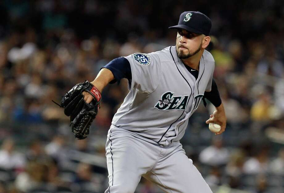 Pitcher pride: The 2012 Mariners recorded the third-best ERA in club history with a cumulative 3.76. Only the 2001 (3.54) and 1990 (3.69) teams were better on the mound. Photo: Mike Stobe, Getty Images / 2012 Getty Images