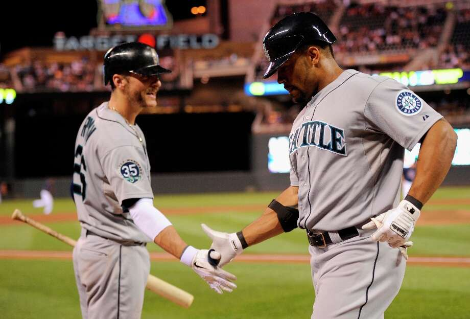Swung on and belted: In addition to hitting 40 more home runs than the 2011 Mariners, the 2012 club put together 18-straight games in which they hit a home run -- good for the second-longest streak in Mariners history (19 games in 1999). Photo: Hannah Foslien, Getty Images / 2012 Getty Images